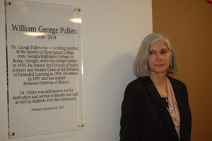 George Pullen's wife, Ann Pullen, stands next to plaque honoring her late husband.
