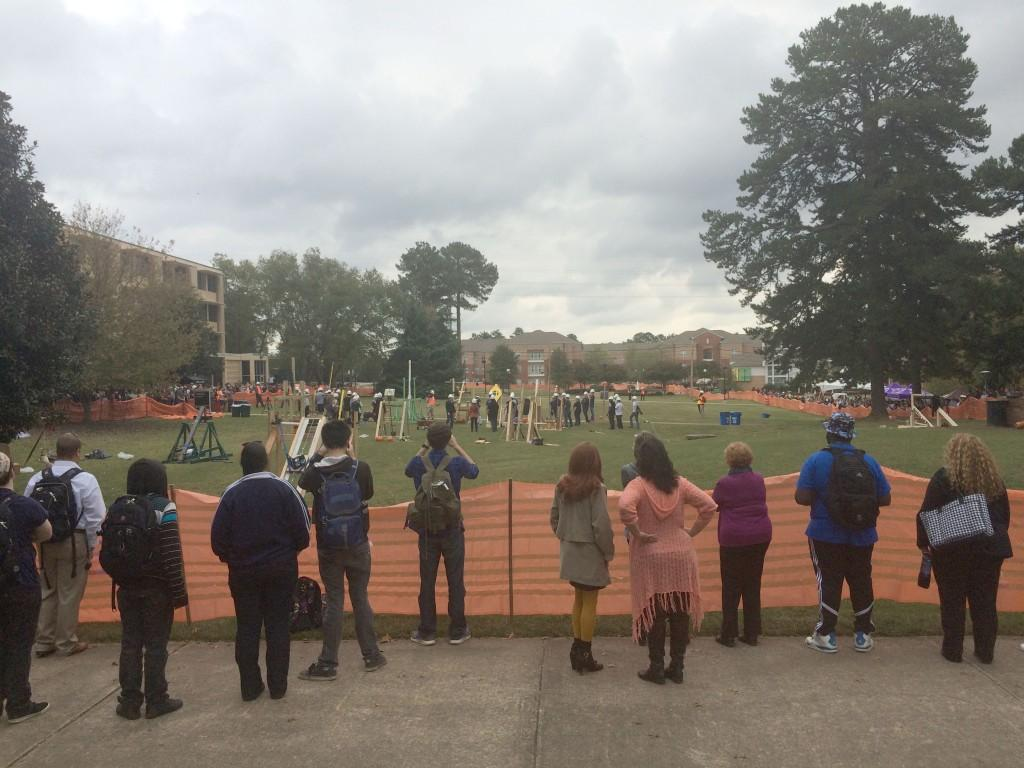 Students gather around to watch freshmen mechanical engineers launch their pumpkins.
