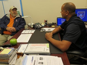 GHC Chief of Police David Horace confers with college Security Officer Ralph Mallad. Photo by Holly Chaney