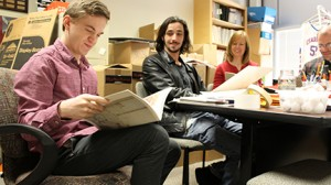 ORK staff and advisers read submissions in their office. They are (from left) Caleb Howard, literary editor; Wesley Sanders, art editor; and faculty advisers Nancy Applegate and John Kwist.