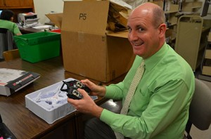Elijah Scott, dean of libraries, explains how to fly the drone, which is equipped with an HD camera. Photo by Taylor Barton