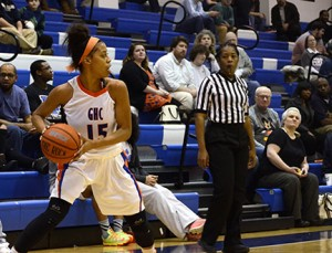 Auriana Broughton throws the ball into play, with a watchful eye from the ref. Photo by Taylor Barton