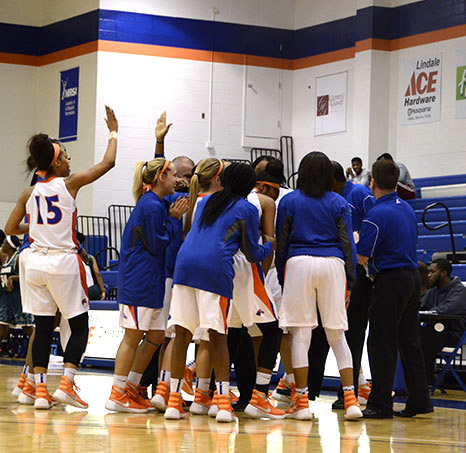 Auriana Broughton high fives with others as the Lady Chargers run away with the game at the end of the third quarter. Photo by Taylor Barton