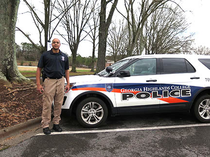 GHC Police Chief David Horace stands beside the police vehicle with the new logo designed by pre-nursing student Kendra Dee Robinson. Photo by Lydia Chandler