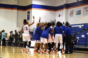 The Lady Chargers huddle up during a time out. Photo by Taylor Barton