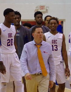 Coach Gaffney (center) leads his team to the court at the men's Region 17 semi-finals. Photo by Taylor Barton