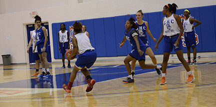 The Lady Chargers practice their moves in the Floyd campus gym. Photo by Jaida Lovelace