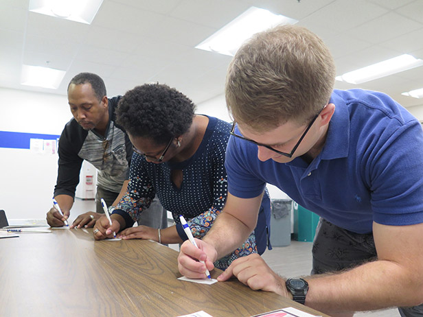 Club members (from left) Justine Dillard, Rodney Dillard and Greyson Oswalt-Smith vote for president in the mock election hosted by the Political Science and Criminal Justice Club at the GHC Floyd Campus. Photo by Luis Martinez