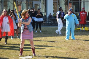 A cowgirl,  baby, variety of superheroes, and other creative costumed individuals gather on the Cartersville campus for a Halloween game of wiffle ball.   Photo by Stephanie Corona