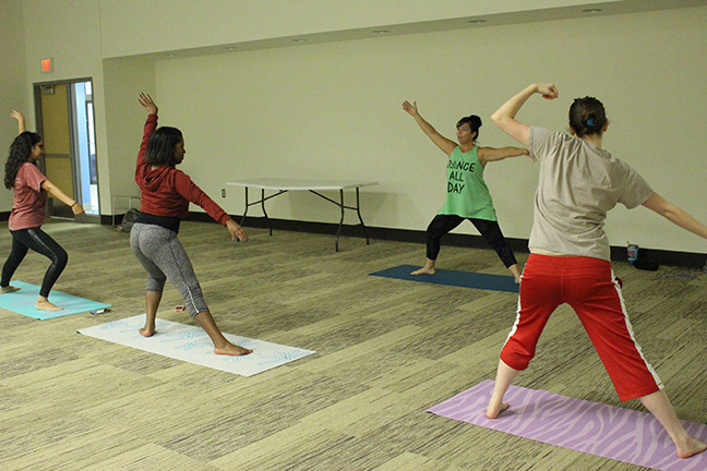 Angie McCanham, yoga instructor, teaches class at the GHC Douglasville campus.  Photo by Michael Lewis
