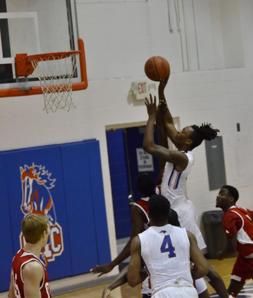 Kyvon Davenport goes for the dunk during the men's basketball game on Nov. 8 at the Floyd campus gym. He contributed 37 points and 8 rebounds as the Chargers defeated Gadsden State 84-72.  Photo by Jaida Lovelace
