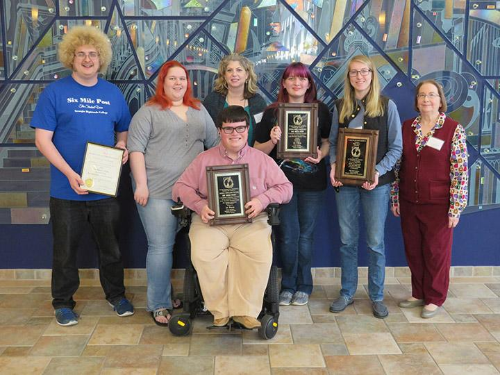 Back row from left, Lucas Caylor, Kacey Neese, Adviser Cindy Wheeler, Kayla Jameson, Margaret Gardner and Adviser Kristie Kemper along with Joshua Mabry, front, bring home several awards from the GCPA press institute.  Contributed photo