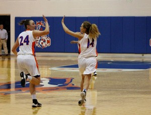 Kateryna Khomenko (24) and Maria Crider high-five during the game on Feb. 22.
