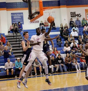 Massamba Dioum goes for a layup during a game earlier this season. Photo by Shannon Francis