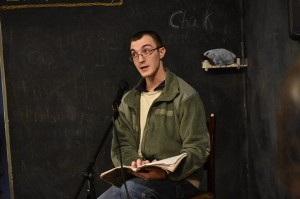 Connor Henderson, a Georgia Highlands College alumnus, reads his work during Poetry Night.  Photo by Mary-Kate Billings