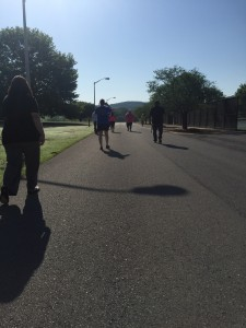 The participants of the FCA Prayer Walk head down next to the gym and tennis courts at the Floyd campus to Paris Lake. Photo by Joshua Mabry