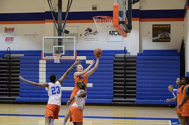 Photo by Xavier Freeman Kateryna Khomenko goes for a shot as she's defended by Cierrah Perdue (23) and Ozahria Fisher.