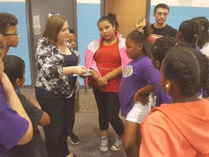 Photo by Moises Ledesma On Sept. 22, Kathryn Garcia (center left), the adviser for the Spanish activities club, and Spanish activity club members instructed children at the Boys and Girls Club.