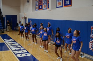 Photo by Jaida Lovelace The Chargers cheerleaders cheer on the men's basketball team during the home opener on Nov. 8.