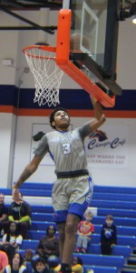 Charger Chris Wright goes for a layup. Photo by Catie Sullivan