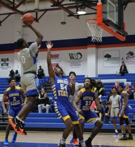 Charger Derrick Cook goes for a rebound. Photo by Catie Sullivan