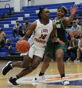 Sharai Lay drives to the basket against East Georgia. Photo by Catie Sullivan