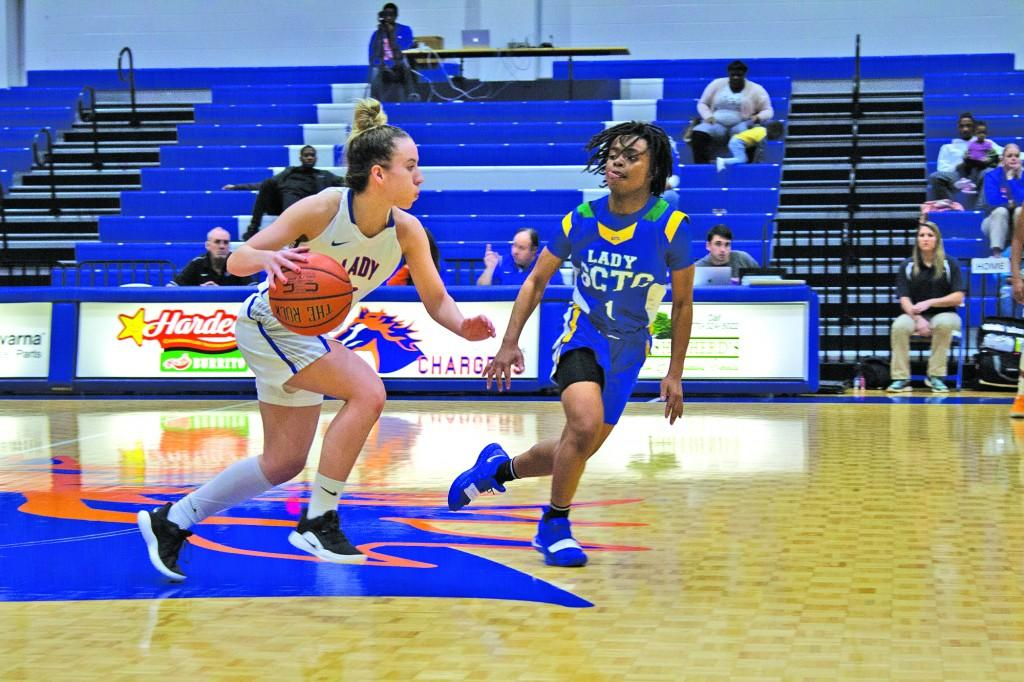 Jessica Eadsforth-Yates dribbles down the court against Southern Crescent Technical College. Photo by Catie Sullivan