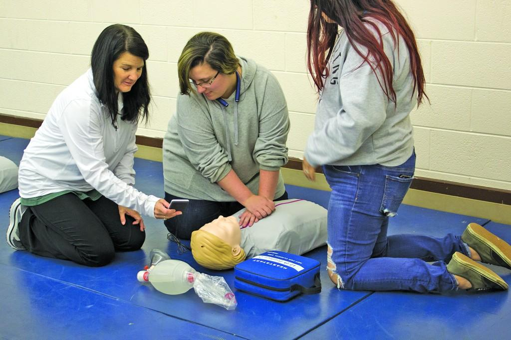 Riaz teaches students how to do CPR. Photo by Kayley Agan