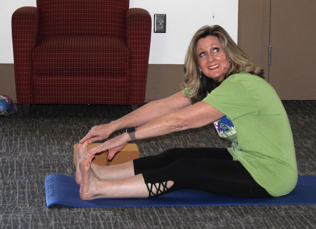 Angie Wheelus, director of Student Support Services, participates in yoga class. Photo by Kayley Agan