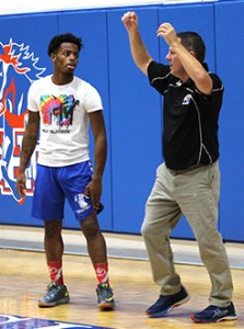 Philip Gaffney, right, talks to Carl Johnson during a practice early in the season. Photo by Lindsay Hamby