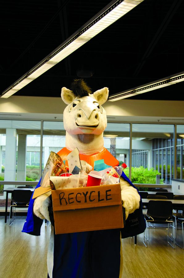 Photo+Illustration+by+Michelle+Hardin%0ABolt+looks+for+a+recycling+bin%2C+but+a+decline+in+student+involvement+has+led%0Ato+fewer+recycling+options.