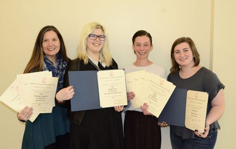 Photo by staff Six Mile Post newspaper faculty adviser, Allison Hattaway, copy editor, Samantha Warner, editor-in-chief, Olivia Fortner and photography editor, Michelle Hardin, receive numerous awards at the annual Georgia College Press Association Institute in Athens, Georgia on Friday, February 14.
