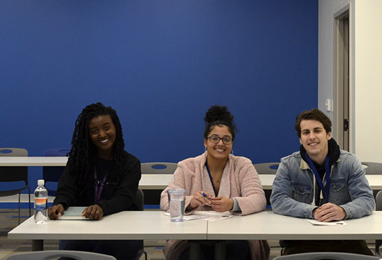 GHC students Nneka Harrison (far left) Akira Dunn (center), and Jackson Benincosa (far right) attended a poetry session at the writers conference. Photo by Michelle Hardin