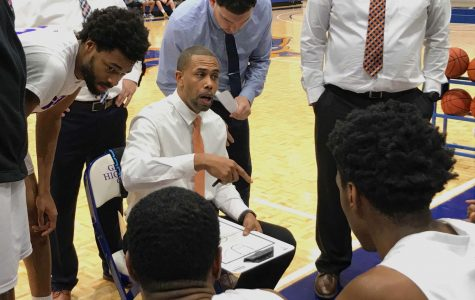 Photo by Brandon Dyer Head Coach, JJ Merritt, draws up a game plan for his players.