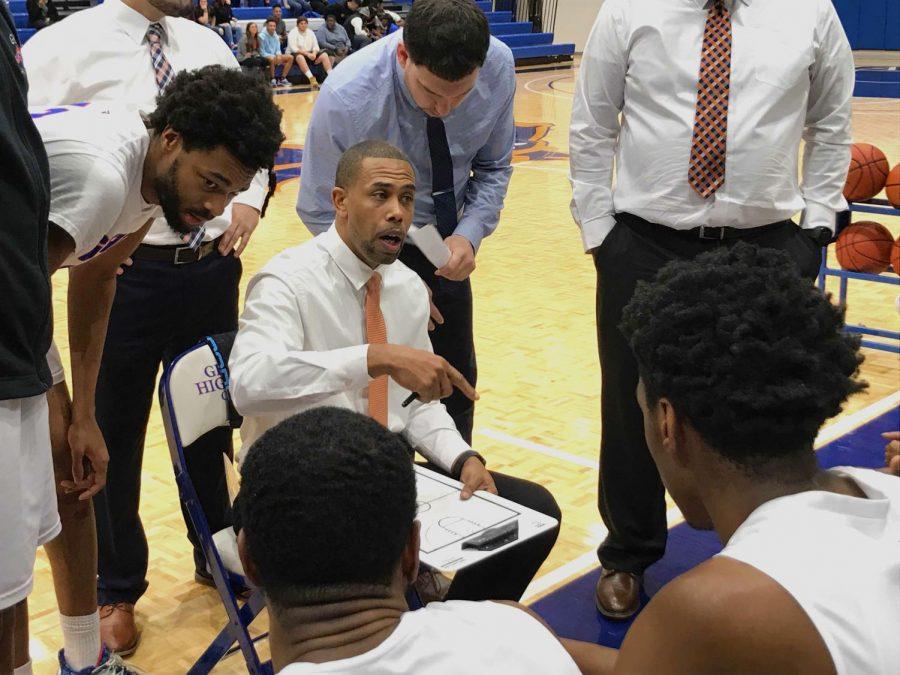 Photo+by+Brandon+Dyer%0AHead+Coach%2C+JJ+Merritt%2C+draws+up+a+game+plan+for+his+players.
