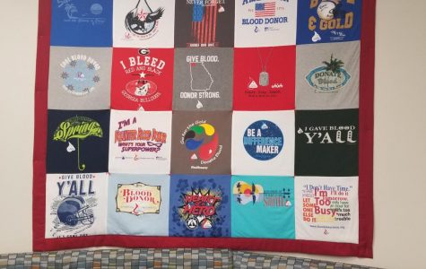 A quilt on the wall at Blood Assurance in Cartersville, made of donor t-shirts. Photo by David Patel, Senior Staff Writer.