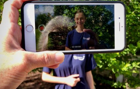 GHC graduate, Olivia Fortner, records for the video yearbook with an iPhone.