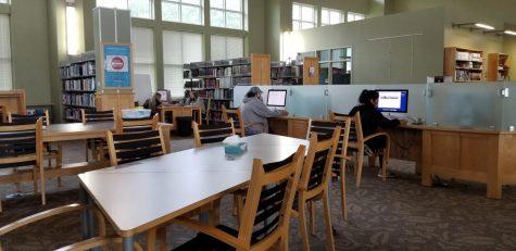 From left, Kelsie Gilbert, Marisa Milligen, April Rhudy, Jimenea Hernandez for in the online area of the Cartersville library.
