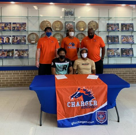 Players and coaches take a picture after signing to their individual schools. Pictured above: Cahiem Brown (bottom left), Langston Wilson (bottom right), Greg Schiefen (top left), J.J. Merritt (top middle) and John Williams (top right).