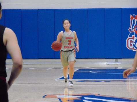 Dribbling the ball up the court, Lady Chargers starting point guard ShaoTung Lin looks to build on the lead that they have in the 3rd quarter of their game against New Horizon Prep on January 30, 2021.