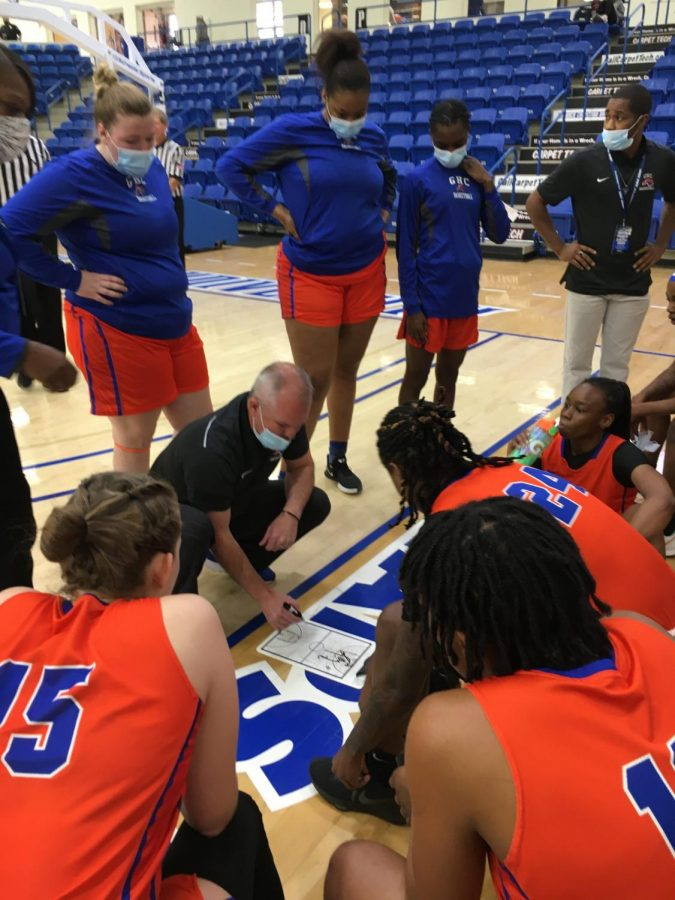 Coach Brandan Harrell gives instructions during a timeout early in the Lady Chargers' second round loss.